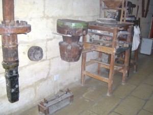 12 - spare parts of the windmill with rat trap on the floor