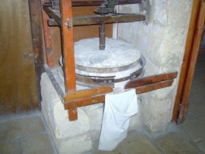 13 - a small grinding mill used for grinding dried broad beans